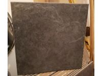 Dark grey/black floor tiles