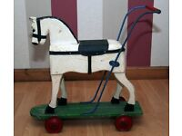 antique wooden horse on wheels