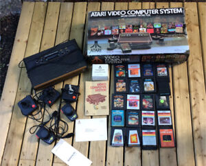 Atari system with 20 games and 5 controllers