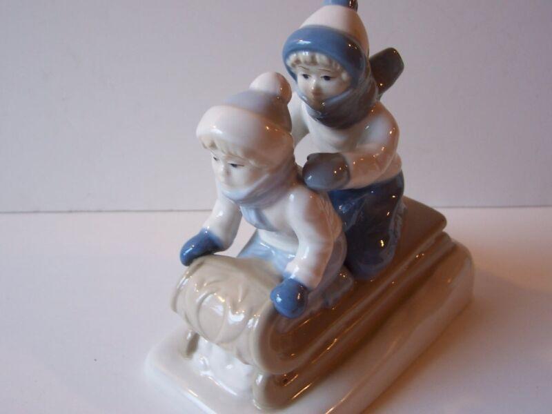 Paul Sebastian PS Mexico Porcelain Figurine Sledding Boys Christmas Holiday 1992