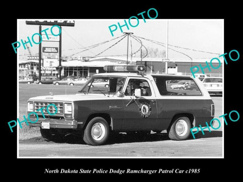 OLD POSTCARD SIZE PHOTO OF NORTH DAKOTA POLICE DODGE RAMCHARGER PATROL CAR 1985