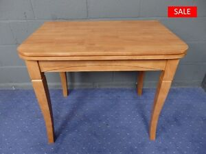Newark Solid Wood Swivel Flip Top Extending Dining Table with Maple Finish