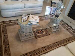Amazing glass and cement column coffee table