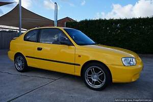 2002 Hyundai Accent 3D Hatchback.Yellow,Wheels.Rego.RWC.Warranty Northgate Brisbane North East Preview