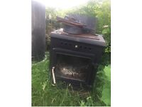 Cast iron stove, suitable for indoors - bit rusted but solid