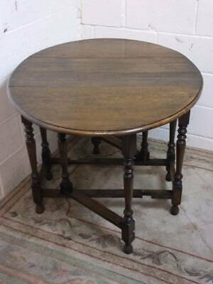 SOLID OAK DROP LEAF GATE LEG DINING TABLE with TURNED SUPPORTS.