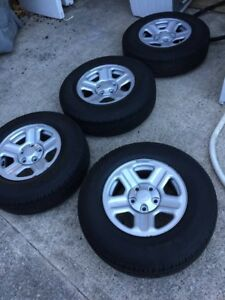 """4x stock Jeep Wrangler 16"""" rims and Goodyear rubber (85-90%)"""
