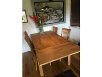 solid oak dining table with xtra leaf and 4 chairs