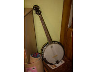 OZARK 4 String Tenor Banjo, possibly ten years old or more but never played