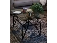Glass and black metal coffee table
