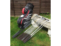 Set of Wilson Clubs and Trolleybag