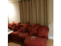 L shaped sofa units, old but good. Feather cushions.