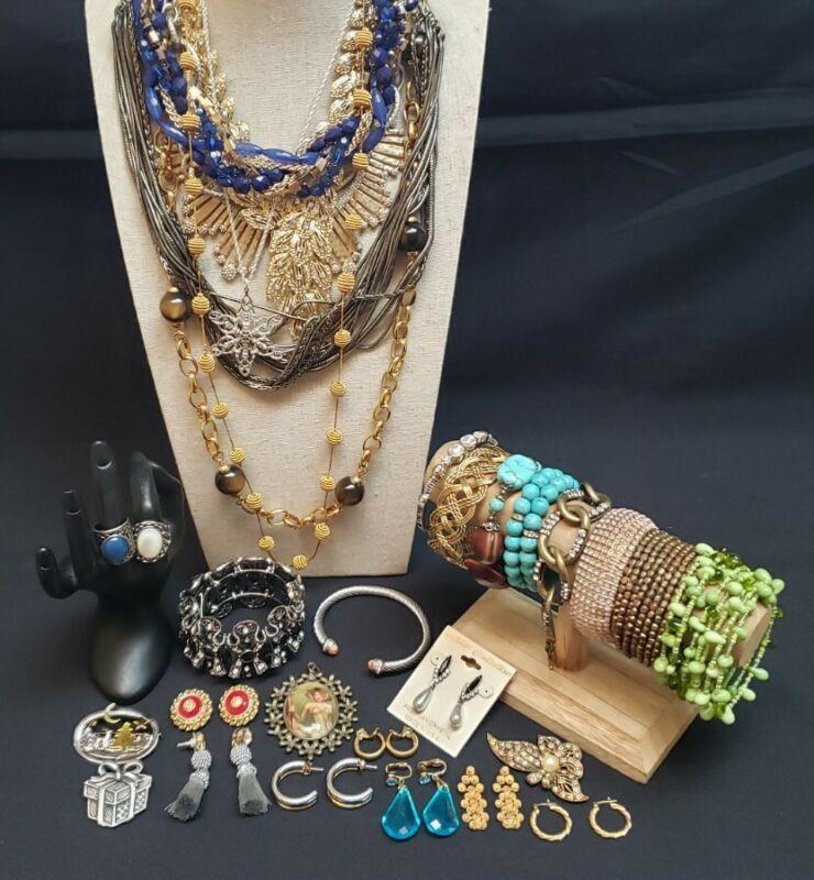 Lot of necklaces rings brooches earrings pendants bracelets bangles designer
