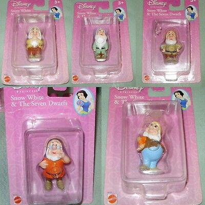 LOT OF SNOW WHITE DISNEY DWARFS VINYL FIGURES  MINT IN PACKAGES