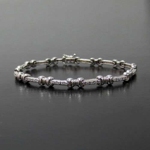 Fine Gerard 0.60ct Perfect Cut Diamond 18k White Gold Bowties Tennis Bracelet