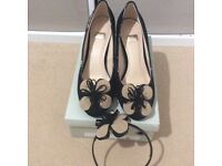 Black and taupe shoes with matching fasinator