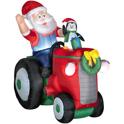 Inflatable Santa On Tractor With Penguin Outdoor Christmas Decor