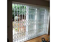 COMMERCIAL WINDOW SECURITY GRILLES BARS GATES FITTED IN BIRMINGHAM WEST MIDLANDS ROLLER SHUTTERS