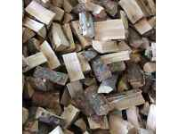 Semi-seasoned larch firewood logs, cut and split timber. Approx 30% moisture, season yourself,