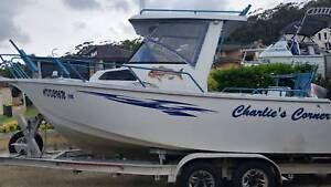 5.8m Pacific Sportsfish Centre Cab plate alloy boat.