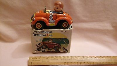 TINPLATE,MADE IN JAPAN IN THE LATE SIXTIES,A BOY IN A MECHANICAL WALKING CAR,VGC
