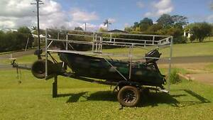 Boat and boat trailer with a modified carry rack on top Malanda Tablelands Preview