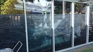 17 Blue tinted, floor to ceiling toughened glass window panels St Lucia Brisbane South West Preview
