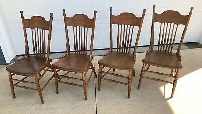 (Matching set of Four Antique Pressed Back Chairs with Solid Wooden Seats)