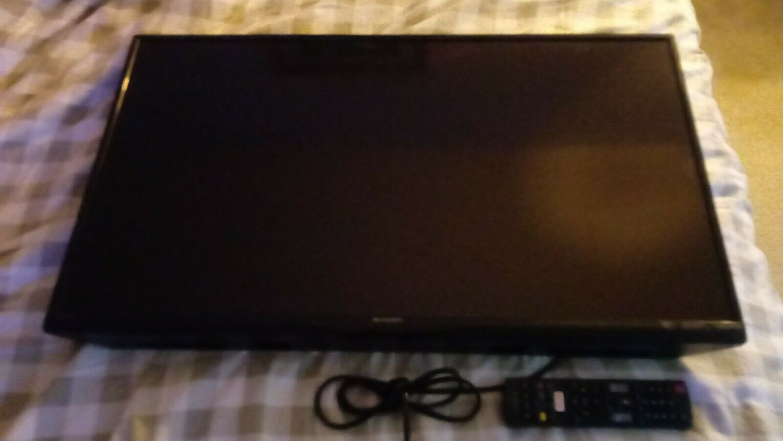 Sharp aquos 32 inch lcd TV with remote no stand