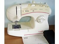 SINGER SEWING MACHINE Model 6038 with foot pedal & user guide