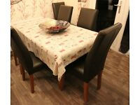 Six Leather and Oak Dining Chairs