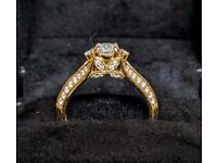 Engagement ring in 18ct gold with 51 diamonds - 0.42ct certificated centre stone