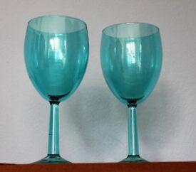 Beautiful brand new turqoise wine glasses. Two sets of 6.