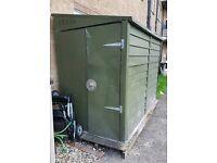 Green metal storage shed