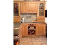 Complete kitchen of 'Limed Oak' solid wood base and wall units plus display cabinets.