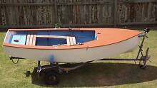 Wooden Heron sailing dinghy with 4HP outboard Coffs Harbour Coffs Harbour City Preview