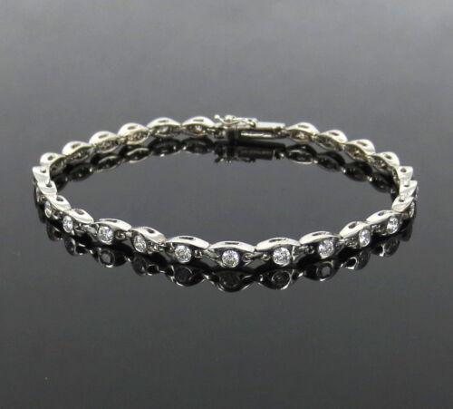 Fine Gerard 1.50ct De/vs Diamond & 18k White Gold Curved Link Tennis Bracelet