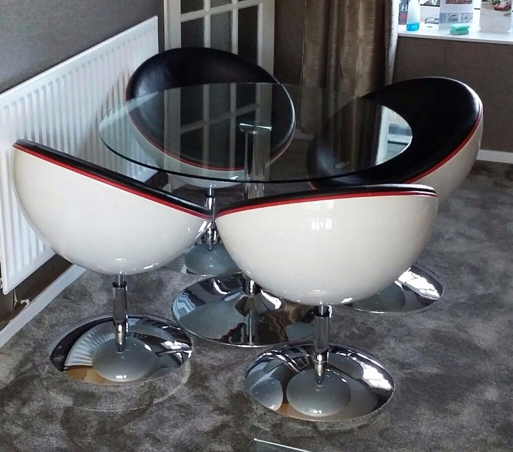 Glass Dining Table and 4 Swivel Half Moon Chairs in Leeds West