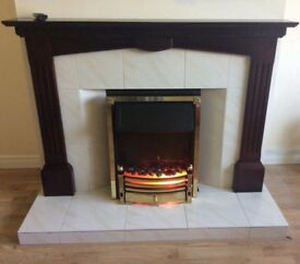 Mahogany fire surround and electric fire inset.