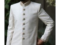 Asian, Pakistani, Indian, Bangladeshi groom's sherwani wedding dress