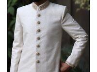 Asian, Pakistani, Indian, Bangladeshi groom's sherwani wedding dress