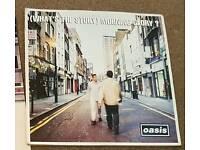Oasis wtsmg 1st press.
