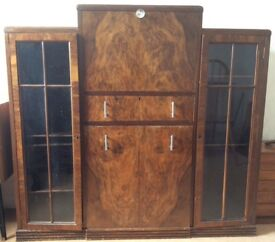 Antique writing desk with integral seat, drawer and bookshelves