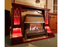 MAHOGANY FIREPLACE WITH MARBLE HEARTH AND SURROUND WITH DISPLAY CABINETS WITH LIGHTS.