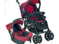 Red pram complete with car seat, carrycot and pushchair
