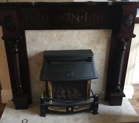 Elegant, mahogany, wooden fireplace, perfect for that cosy feel!