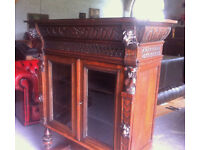 Heavily carved oak bookcase / cabinet