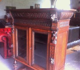 Heavily carved oak bookcase