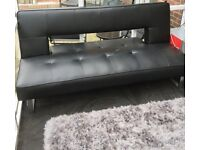 Black leather sofa bed free to a good home. Collection only