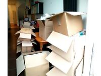 Cardboard moving boxes, packing material and tape gun